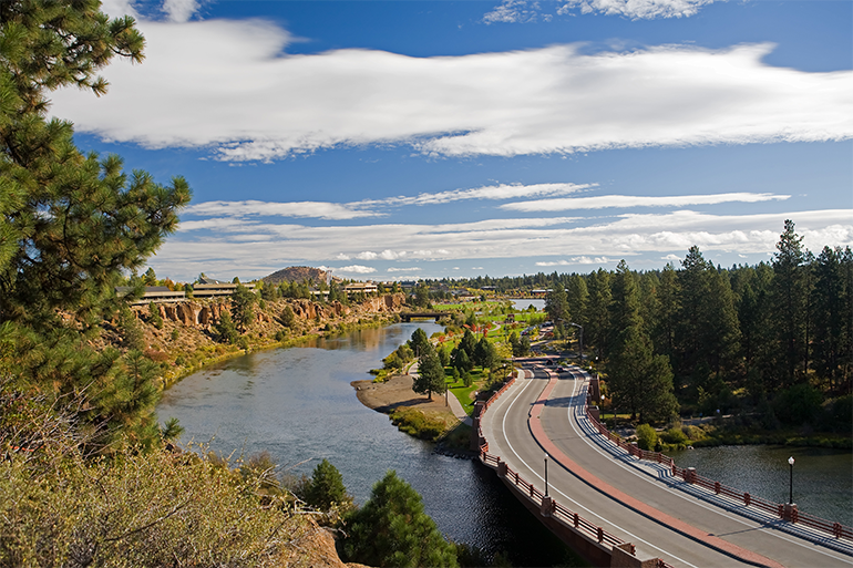 A bridge crosses a river in Bend.